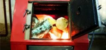 Отопительный котел на твердом топливе для дома: фото